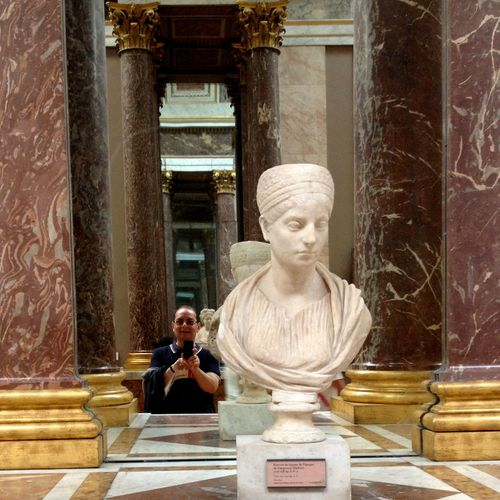 Reflection in a mirror at the louvre museum Statue Religion Spirituality Sculpture Architecture Sitting Built Structure Travel Destinations Indoors