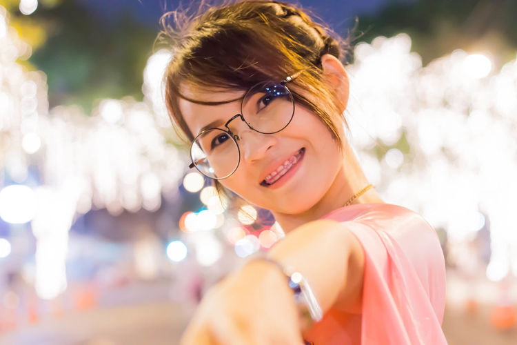 Thai Sty Thai Girl Thailand Adult Beautiful Woman Beauty Emotion Eyeglasses  Glasses Hairstyle Happiness Headshot Leisure Activity Lifestyles Looking Looking At Camera One Person Outdoors Portrait Smiling Women Young Adult Young Women