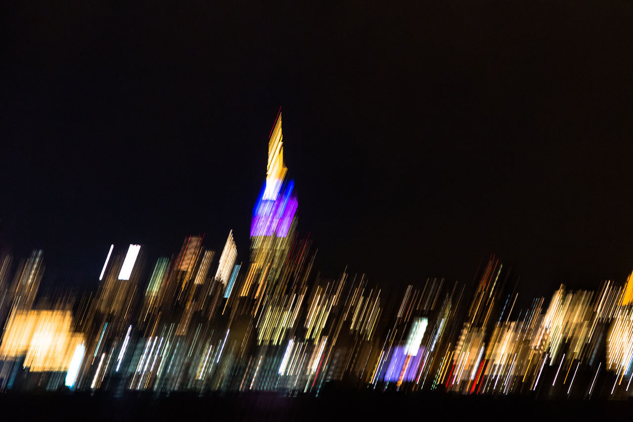 night, blurred motion, illuminated, long exposure, speed, low angle view, motion, architecture, no people, multi colored, outdoors, building exterior, built structure, water, sky