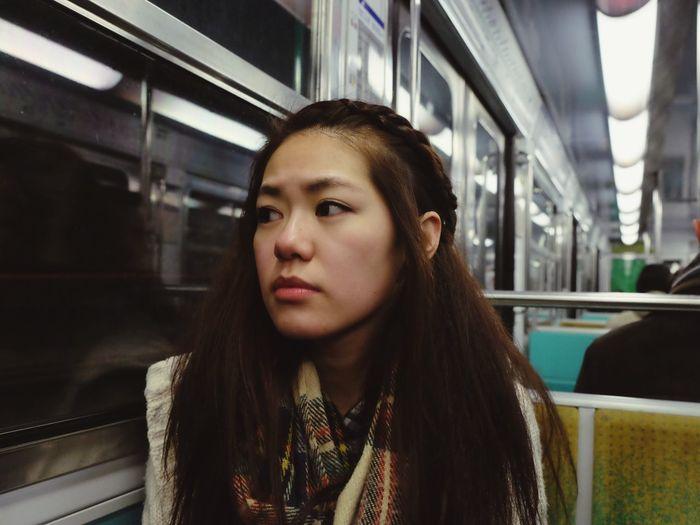 Portrait of beautiful woman on public transport