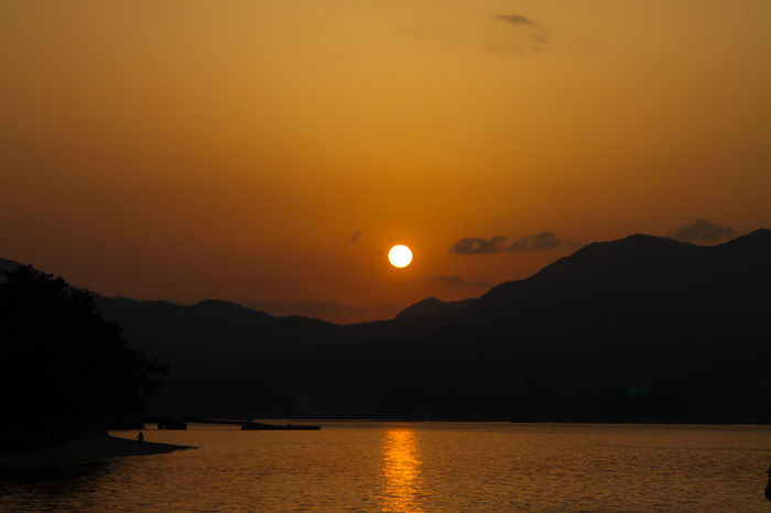 Sunset Astronomy Beauty In Nature Full Moon Japan Japan Photography Lake Lake View Landscape Moon Mountain Mountain Range Nature No People Ocean Outdoors Reflection Scenics Silhouette Sun Sunset Tranquil Scene Tranquility Travel Destinations Water Finding New Frontiers