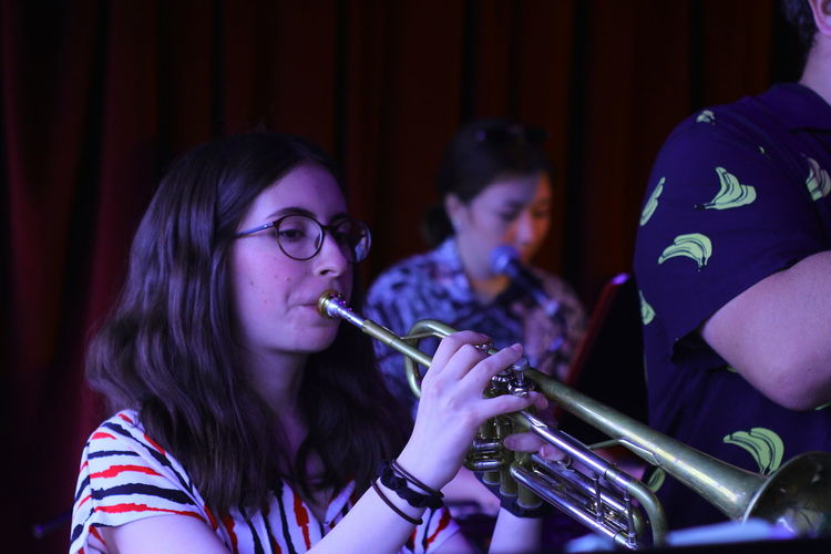 Females playing trumpets on stage