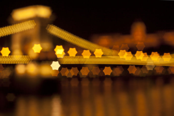 The Chain Bridge of Budapest, out of focus, with star-shaped bokeh. Bokeh Buda Castle Budapest Chain Bridge Christmas Lights Cityscapes Danube Dark Depth Of Field Hungary INDUSTAR-61 L/Z MC 50mm F2.8 Night Nightscape Seeing The Sights Star Bokeh Vintage Lenses