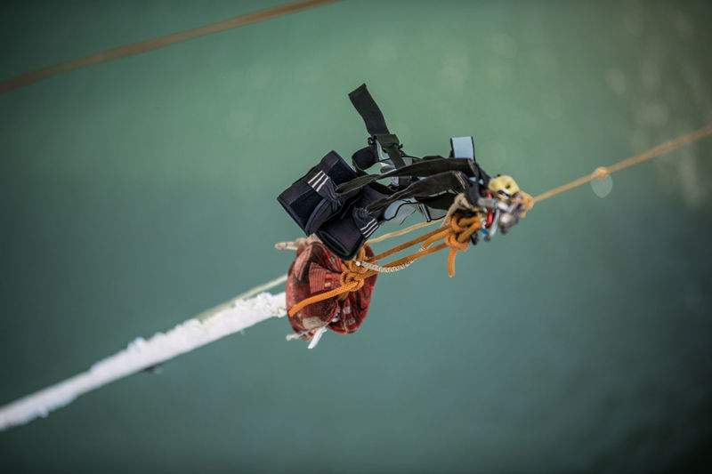 Close-up of bungee equipment hanging on rope