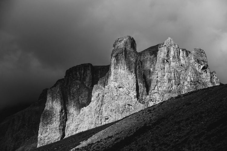 Passo di Sella Rock - Object Geology Rock Formation Sky Mountain Nature Physical Geography Cloud - Sky Cliff Low Angle View Outdoors Day No People Beauty In Nature Tranquility Textured  Scenics Dolomiti Italy Sella