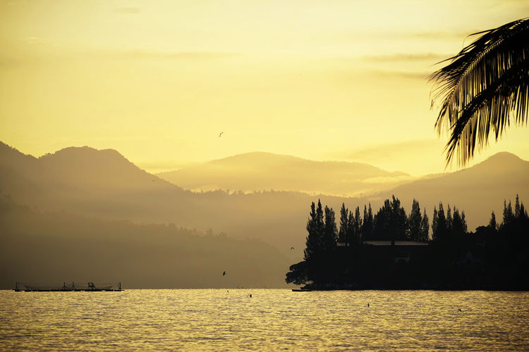 Sumatra  Toba Lake Beauty In Nature Day Lake Mountain Mountain Range Nature No People Outdoors Scenics Silhouette Sky Sunset Tranquil Scene Tranquility Tree Water Waterfront