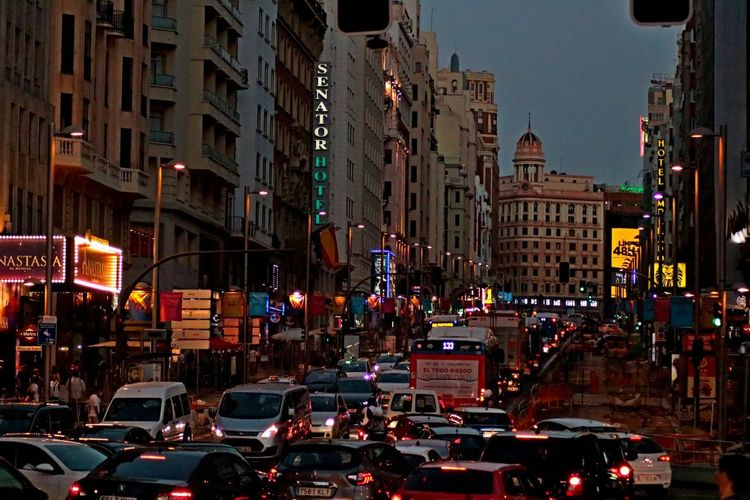 EyeEmNewHere Madrid SPAIN Architecture Building Building Exterior Built Structure Busy Car City City Life City Street Granviamadrid Illuminated Incidental People Land Vehicle Mode Of Transportation Motor Vehicle Night Outdoors Road Street Traffic Transportation Travel