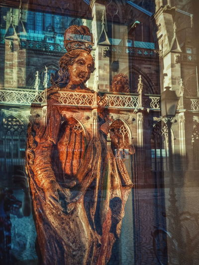 Strasbourg cathedral in reflection First Eyeem Photo Statue Reflection Cathedral Bicycle France Day Mirror Orange Color Street Photography light and reflection Xiaomi Mi4c