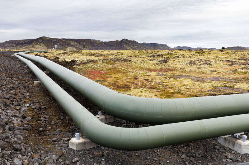 Insulated metal pipeline as part of geothermal energy generation infrastructure in barren volcanic landscape of Iceland, IS, Europe Iceland Europe Eu Travel Trip Destination Landscape Pipe Pipeline Pipes Geothermal  Geothermal Source Energy Geothermal Energy Infrastructure Insulated Power Generation Industry Industrial Barren No People Outdoors Nature Environment Land Mountain Scenics - Nature Pipe - Tube Fuel And Power Generation Non-urban Scene Architecture Metal