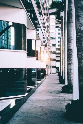 Empty walkway by building