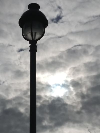 Something about the sunlight peeking through the gray clouds speaks to me Gray Clouds Gray Sky Blackandwhite Cloud - Sky Blackandwhite Photography Natural Light Hintofblue Landscape Lamp Post Street Light Cloudy Day Cloudy Cloudy Sky Dramatic Sky