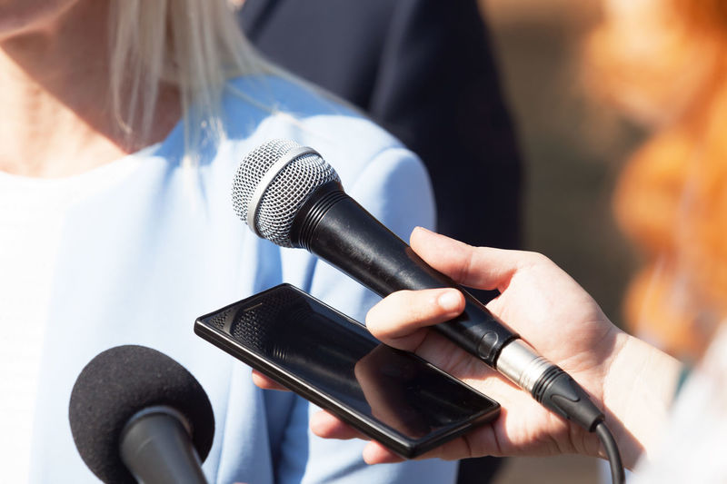 Journalists making media interview with businesswoman or a female politician Microphone Input Device Report Reporting Reporter Journalism Journalist Media The Media Broadcasting Media Interview Interview Recording Public Relations Statement News Promotion Self Promotion Public Figure Publicity Publicimage Press Conference Press News Conference Communication