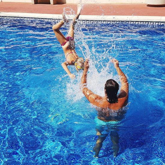Jump Jump Jumping Water Reflections Summer Summertime Holidays Vacations Spain♥ Water Swimming Swimming Pool Togetherness Competitive Sport Competition Blue Men Be Brave This Is Strength 50 Ways Of Seeing: Gratitude Moments Of Happiness 2018 In One Photograph Exploring Fun