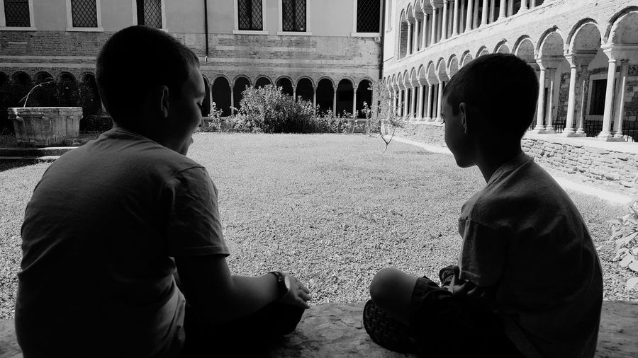 Two People Togetherness Architecture Sitting Outdoors Friendship Brothers