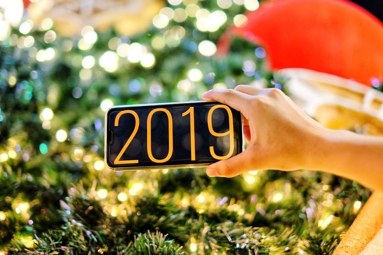 Happy New Years 2019 Human Hand Tree Christmas Decoration Christmas christmas tree Celebration Text Holiday - Event Close-up Christmas Lights Christmas Market December Religious Event New Year's Day Festival Christmas Present Christmas Ornament Christmas Stocking Gift Box New Year's Eve