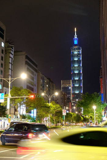 Taiwan Taipei 台北 台湾 Fujifilm Fujifilm_xseries X-t2 FUJIFILM X-T2 Taipei 101 Illuminated Architecture City Night Building Exterior Built Structure Car Motor Vehicle Mode Of Transportation Office Building Exterior Land Vehicle Street Building Blurred Motion Motion Tower Tall - High No People City Life Skyscraper Outdoors