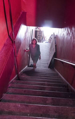 Steps Staircase Steps And Staircases Full Length Railing The Way Forward One Person Lifestyles Real People Stairs Moving Down Young Adult Indoors  Day Young Women Architecture People Adult Looking At Camera Light And Shadow Mystery Darkness And Light Femme Fatale