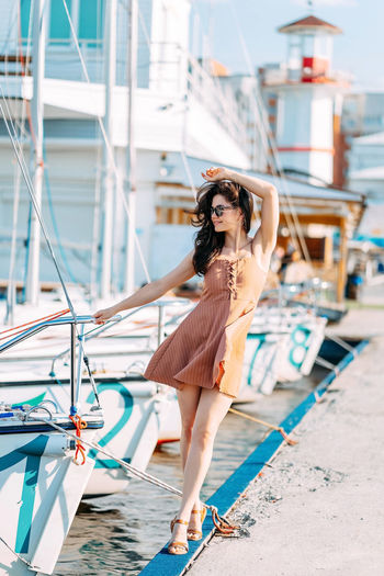 Full length portrait of young woman in boat
