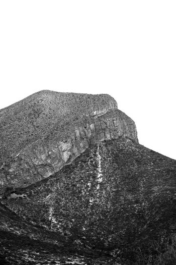 Desaturated. White Background Close-up Sky Rugged Rock Formation Physical Geography Rock - Object Eroded Geology Rocky Mountains Natural Arch Rock Hoodoo Natural Landmark Stack Rock Canyon Cliff