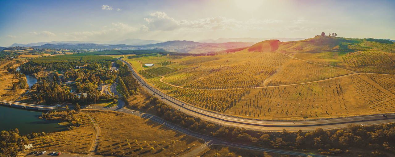 Aerial panorama of beautiful countryside at sunset in Canberra, Australia Australia Canberra Drone  National Park Panorama Panoramas Panoramic Rural Aerial Aerial View Arboretum Australian Capital Territory Beauty In Nature Cloud - Sky Day Drone Photography Highway Landscape Mountain Mountain Range Mountain Road Nature No People Outdoors Panoramic Photography Road Rural Scent Scenics Sky Tranquil Scene Tranquility Travel Destinations Winding Road