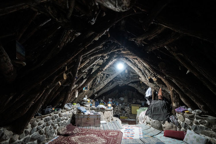 Travel Destinations Travel Photography Iran Shia Community Nomadic Zoroastrian Islamic Architecture Indoors  Architecture Real People Belief Cave Built Structure Place Of Worship Spirituality People Men History Illuminated Group Of People Lighting Equipment Building Incidental People The Past Travel