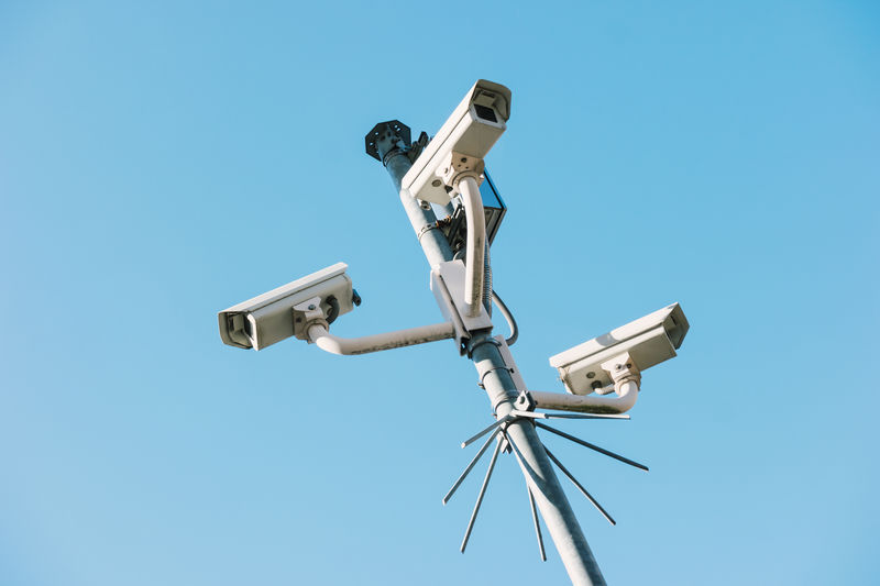 security cameras watching Camera Corrugated Crime Iron Safety First! Security Spying Big Brother - Orwellian Concept Blue Sky Criminal Day Group Of Objects Monitoring No People Outdoors Police Prickle Protection Safe Safety Security System Spy Surveillance Camera Technology Watching