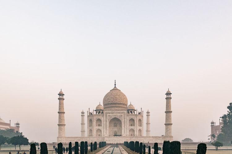 Taj mahal at foggy sunrise in winter