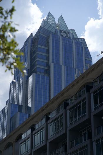 Low angle view of modern building against sky in city