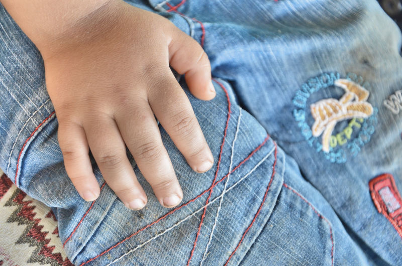 Midsection Of Boy Wearing Jeans