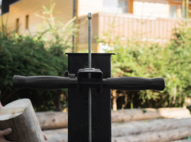 A firewood split with wooden splitter outdoor Machine Worker Close-up Day Firewood Focus On Foreground Garden Hydraulic No People Outdoors Splitting