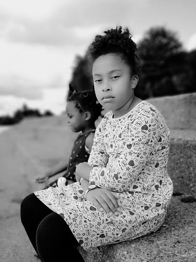 Grumpy Blackandwhite Check This Out EyeEm Best Shots Child Childhood Portrait Togetherness Sitting Girls Females Elementary Age Sky Close-up Monochrome Only Girls Thoughtful