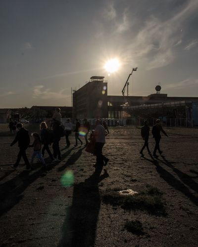 Tempelhof freedom. Group Of People Crowd Sky Real People Large Group Of People Sport #FREIHEITBERLIN Nature Men Lifestyles Sunlight Architecture Sunset Built Structure City Group Leisure Activity Shadow Building Exterior
