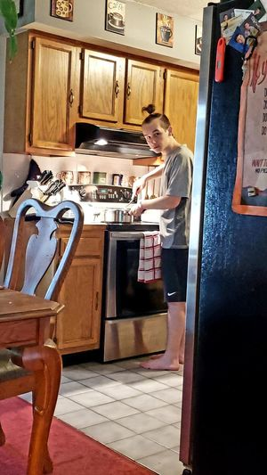 Stove Cooking Son Making Dinner Kitchen Wood - Material Stirling Man Bun Chair Towel Prepare Look At Camera