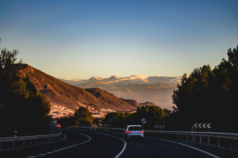 Road with Sierra Nevada in the background Copy Space Mountain Sky Transportation Road Motor Vehicle Nature Car Mode Of Transportation Beauty In Nature Direction Land Vehicle The Way Forward Mountain Range Scenics - Nature Non-urban Scene No People Sierra Nevada Trip Travel Road Transportation