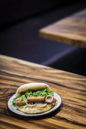 asian style bao pork sandwich Asian Snack Chinese Food Food And Drink Sandwich Snack Tapas Asian Food Asian Sandwich Bao Close-up Focus On Foreground Food Food And Drink Freshness Fusion Food Healthy Eating Hipster Indoors  No People Plate Pork Sandwich Ready-to-eat Table Trendy Food Wood - Material