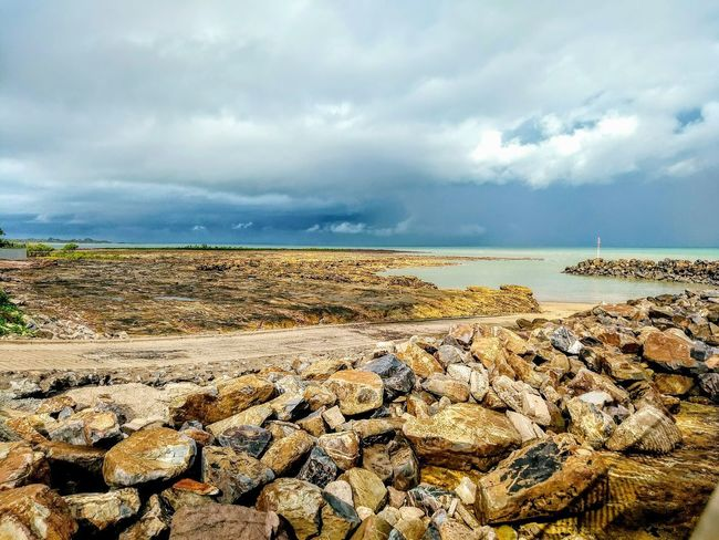 Storm Cloud Sand Low Tide Water Pebble Sky Horizon Over Water Cloud - Sky Rock Formation Dramatic Sky Atmospheric Mood Pebble Beach