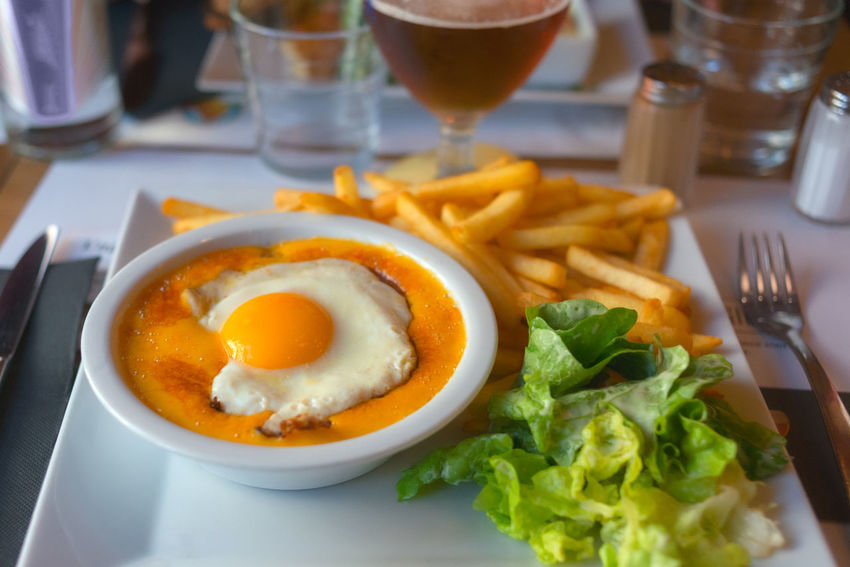 A Welsh rarebit typical dish in the North of France. Lille, France. Cheddar France Welsh Welsh Rarebit Cheese Close-up Egg Fast Food Food Food And Drink French Fries Freshness Fried Fried Egg Frites Healthy Eating Indoors  Meal No People North Plate Potato Ready-to-eat Table Vegetable