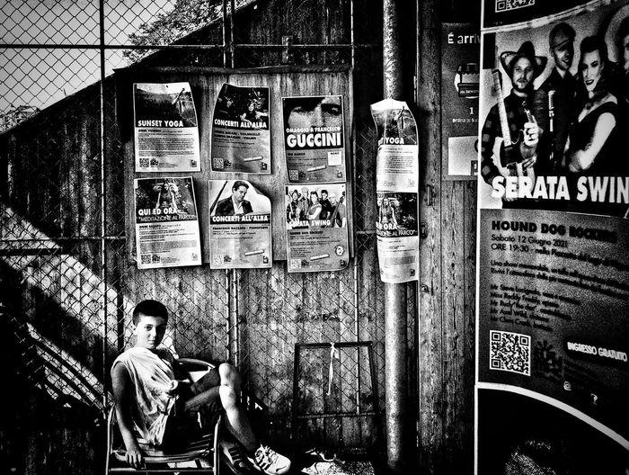 Portrait of man sitting on wall