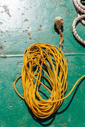 monkey fist Rope Day High Angle View No People Close-up Tied Up Still Life Strength Yellow Water Outdoors Tangled Complexity Turquoise Colored Fishing Industry Monkey Fist Knot Knot