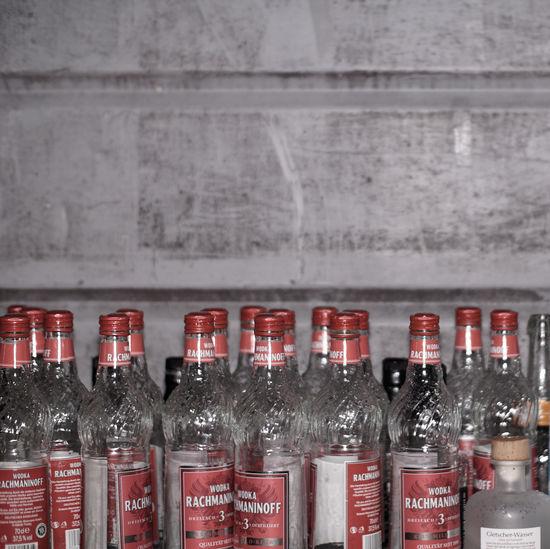 Glass bottles on shelf at home