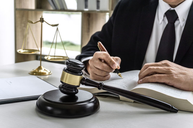 Business Adult Men Holding Business Person Pen Paper Businessman Hand Occupation Human Hand Sitting Formal Businesswear Advocate Counselor Fairness Barrister Lawyer Legal Legislation Verdict Notary Gavel Balance Courtroom