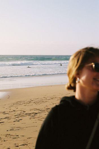 Portrait of man on beach against clear sky