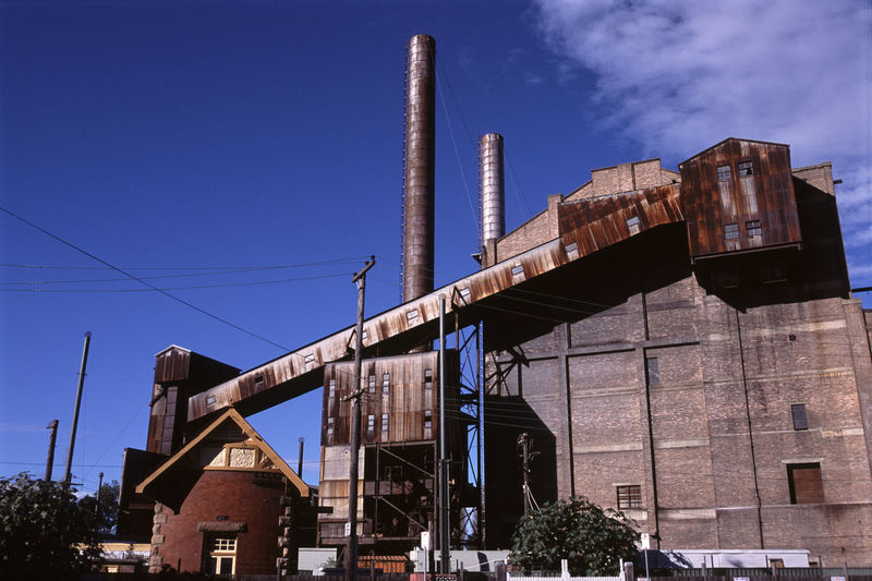 Low Angle View Of Abandoned Factory Against Sky