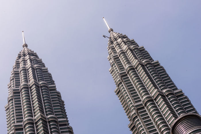 The Petronas Twin Towers Architecture Building Exterior Built Structure City Day History Kuala Lumpur Low Angle View Malaysia No People Outdoors Petronas Petronas Twin Towers Sky Skyscraper Tourist Attraction  Travel Destinations