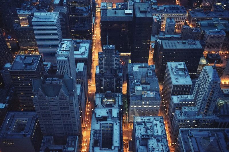 Low angle view of illuminated cityscape at night