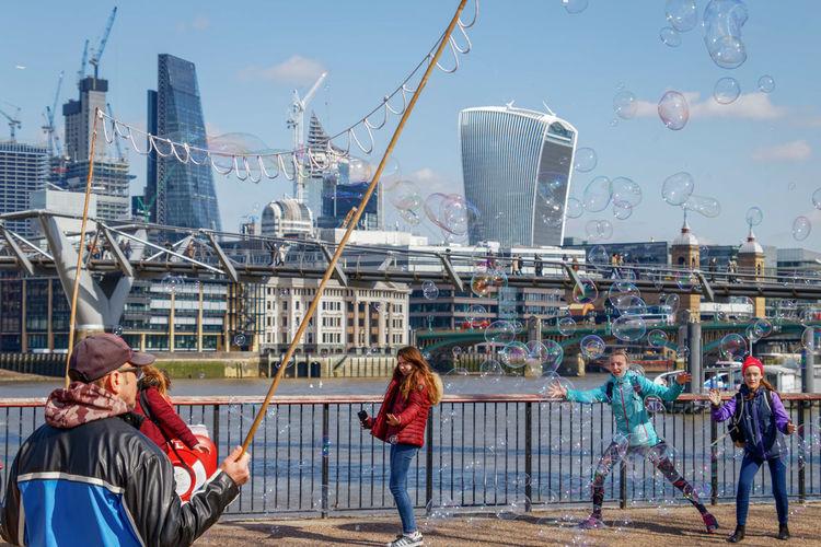People in boat against buildings in city