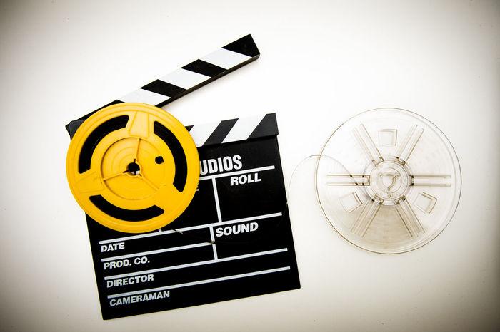 Vintage super 8 movie reels and clapper board Celluloid Cinema Clapboard Clapper Clapperboard Entertainment Film Filmstrips Movies No People Super 8