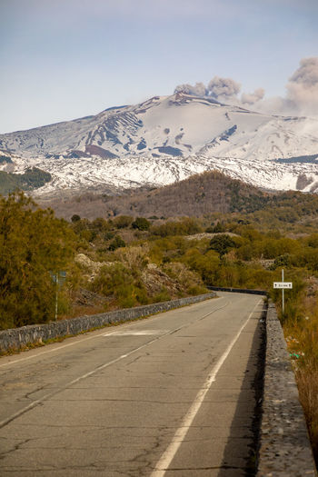 Etna Volcano Sicilia Italy Sicily Winter Snow Mountain Road Transportation Beauty In Nature Scenics - Nature Cold Temperature Nature Sky Direction Snowcapped Mountain The Way Forward Symbol Road Marking Mountain Range Marking No People Tranquility Diminishing Perspective Outdoors Mountain Peak
