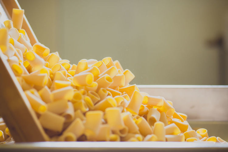 Pasta being manufactured on machinery