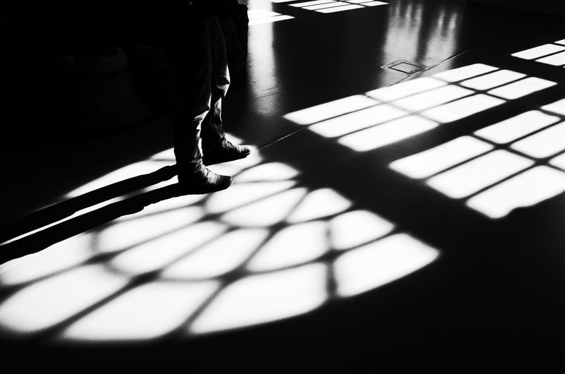 Shadow Indoors  Sunlight Standing Real People Day One Person Low Section Close-up People Window Flower Light And Shadow Blackandwhite Art Building Structure Shape Sun Afternoon Architecture Interior Fresh On Market 2017